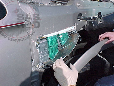 CONTRABAND HIDDEN IN EXTERIOR PANEL OF VEHICLE
